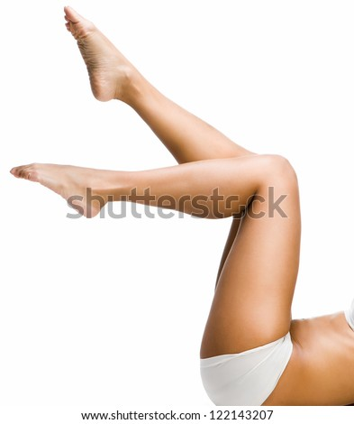 Perfect female legs isolated over white background - stock photo