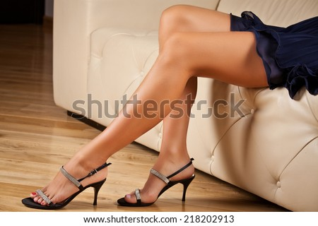 Perfect female legs wearing high heels - stock photo