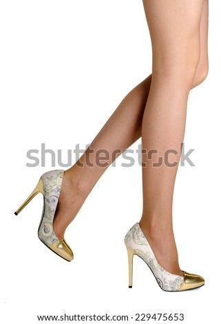 Perfect female legs wearing mottled high heel shoes  isolated on white background.  - stock photo