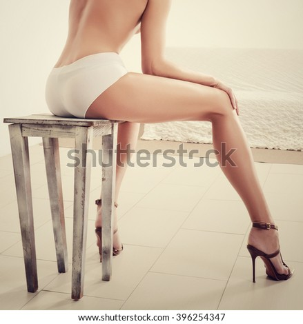 Perfect female legs with heels - stock photo