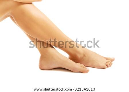 Perfect female slim nude legs. - stock photo