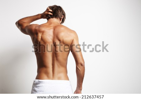 perfect fit man from the back in the white towel - stock photo