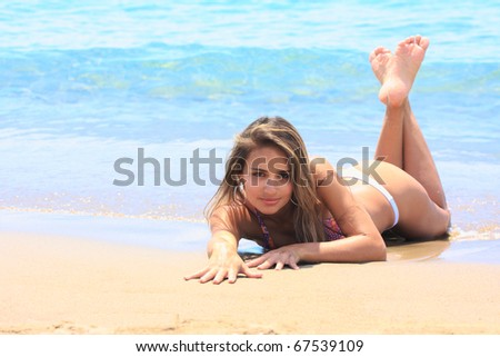 Perfect girl relaxing on the beach in the summertime - stock photo