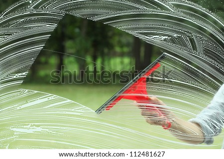 Perfect glass cleaning,housework with special squeegee - stock photo