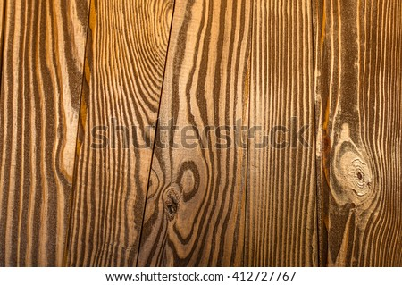 Perfect irregular old and rough wood timber close-up texture background. This decently polished wood background texture has a beautiful irregular and natural ambience which gives it an authentic feel. - stock photo