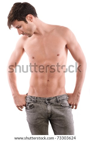 Perfect male half naked in jeans posing and looking by the side. - stock photo