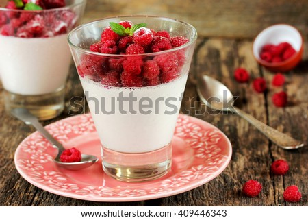 Perfect panna cotta with fresh raspberries in glass, summer dessert, traditional Italian cuisine selective focus - stock photo