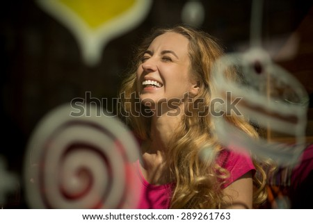 Perfect portrait of friendly approachable girl with a stunning smile. Woman with thick hair resting in cafe. - stock photo