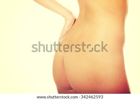 Perfect slim naked woman's ass. - stock photo
