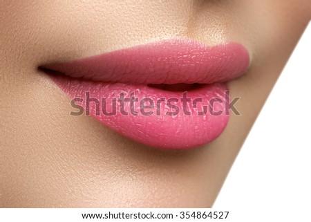 Perfect smile. Beautiful full pink lips. Pink lipstick. Gloss lips. Make-up & Cosmetics - stock photo