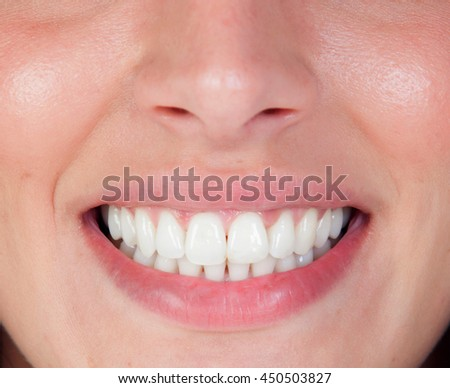 Perfect smile of a beautiful young woman. Teeth close - stock photo