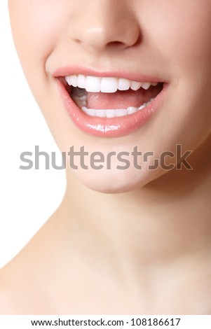 Perfect smile of beautiful woman with great healthy white teeth. Isolated over white background - stock photo