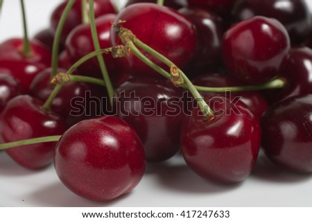 perfect sweet cherries isolated on background - stock photo