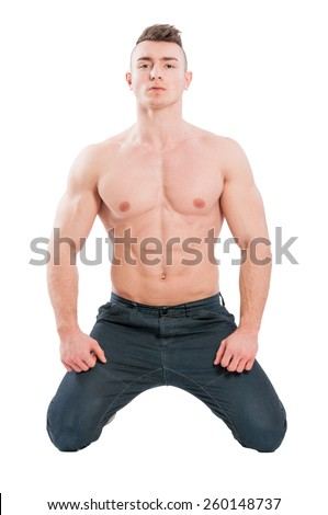 Perfect torso and abs male model on his knees isolated on white studio background - stock photo