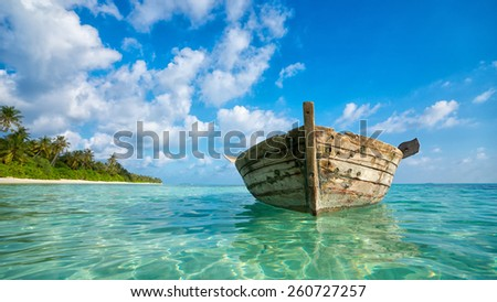 Perfect tropical island paradise beach and old boat - stock photo