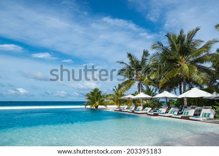 Perfect tropical island paradise beach and pool - stock photo