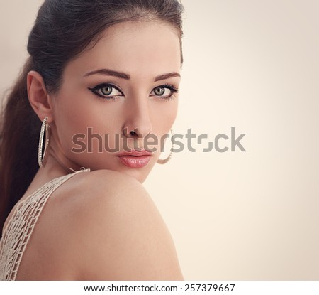 Perfect woman face looking with mystery green eyes. Closeup art portrait - stock photo