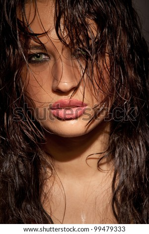 Perfect young model portrait in dark tones - stock photo