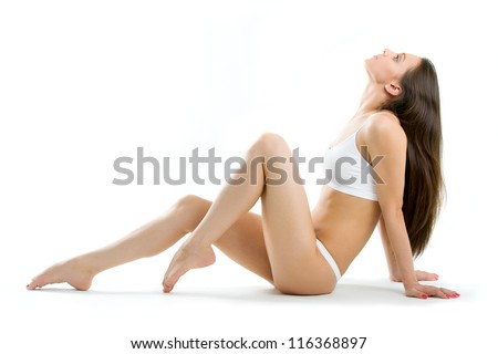 Perfection of women with clean fresh skin and with beautiful legs - stock photo