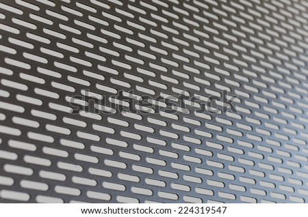 Perforate metal sheet as background image - stock photo