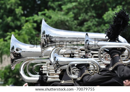 Performers Playing Marching Tubas and Baritones in Parade - stock photo
