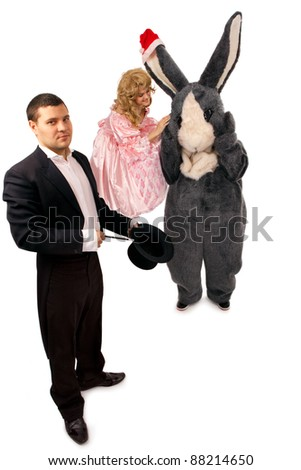 Performing magician with marionette and rabbit over white background - stock photo