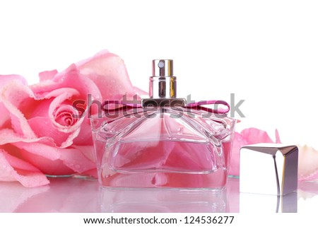 Perfume bottle and pink rose isolated on white - stock photo