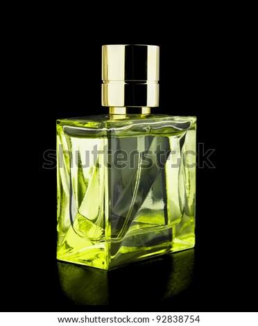 Perfume bottle isolated on black background - stock photo