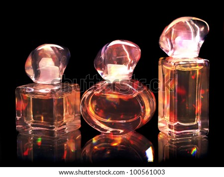 Perfume bottles isolated on black background. - stock photo