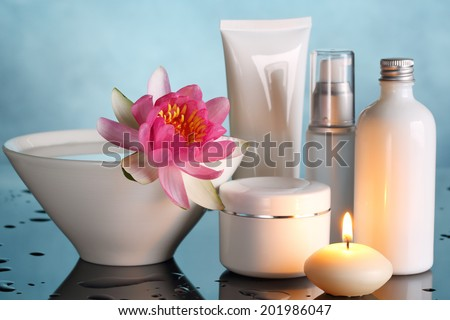 Perfume bottles with lotus flower - stock photo