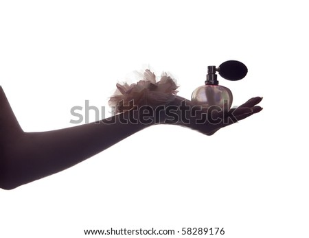 Perfume;hand of a woman holding a bottle of perfume - stock photo