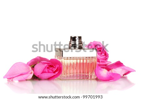 perfume in a beautiful bottle, petals and pink roses isolated on white - stock photo