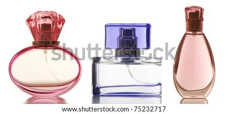 Perfume in a glass bottles on white background - stock photo