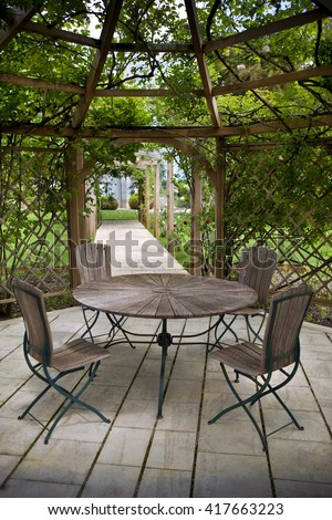 Pergola and a rose garden in a French park - stock photo