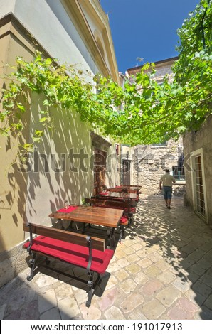 pergola on a street Kotor Old Town, Montenegro - stock photo