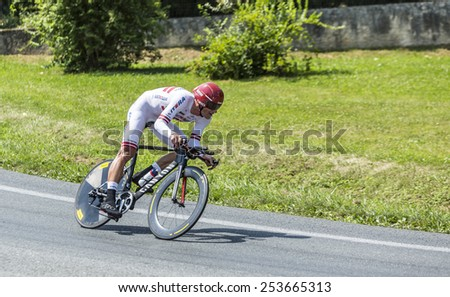 PERIGEUX,FRANCE-JUL 26: The Latvian cyclist Gatis Smukulis (Katusha Team) pedaling during the stage 20 ( time trial Bergerac - Perigueux) of Le Tour de France 2014.  - stock photo