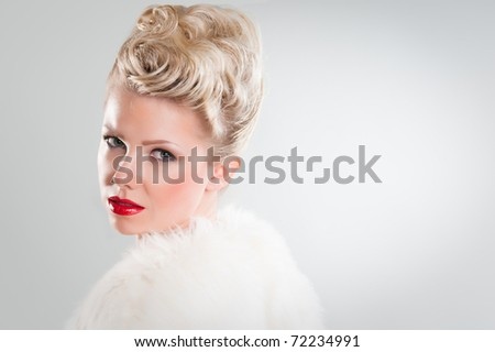 perky young woman wearing fur coat - stock photo