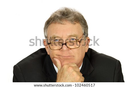 Perplexed middle aged businessman with glasses looking at camera. - stock photo