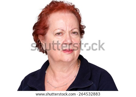 Perplexed senior lady with a puzzled frown staring intently at the camera with an unconvinced expression, isolated on white - stock photo