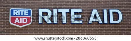 PERRYSBURG, OH - JUNE 2: Rite Aid, whose Perrysburg, OH location logo is shown on June 2, 2015, has over 4,600 stores.  - stock photo