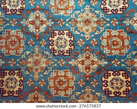 Persian carpet - texture background with oriental ornament. Traditional wool rug - oriental craft, decor of home interior. - stock photo