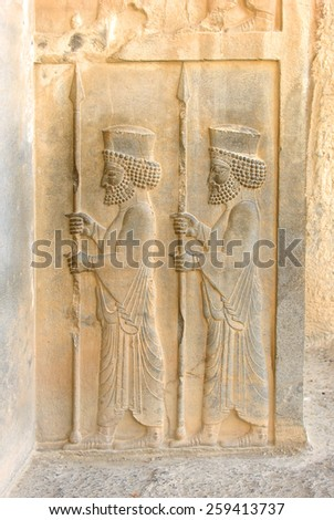 Persian soldiers on a bas-relief stone carving at the site of Persepolis, capital of the ancient Persian empire, located near Shiraz, Iran. Persepolis became a UNESCO World Heritage Site in 1979. - stock photo