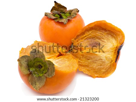 Persimmon fruits on a white background - stock photo