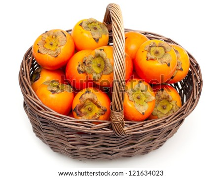 persimmons in a basket - stock photo