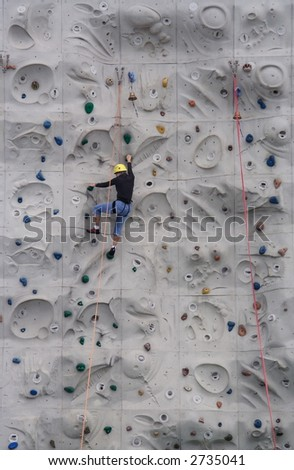 Person climbing on a wall - stock photo