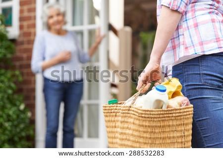Person Doing Shopping For Elderly Neighbor - stock photo