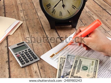 Person filling federal tax just before deadline - stock photo
