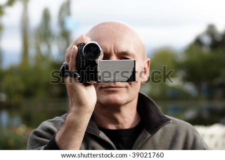 [Image: stock-photo-person-filming-a-scene-with-...021760.jpg]