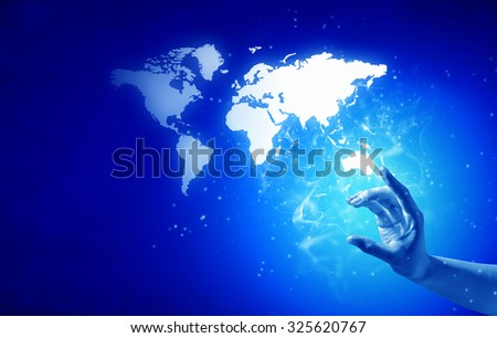 Person hand taking world map on blue background - stock photo