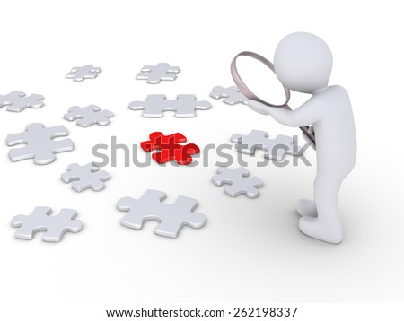 Person holding a magnifier is looking at many puzzle pieces but one is different - stock photo